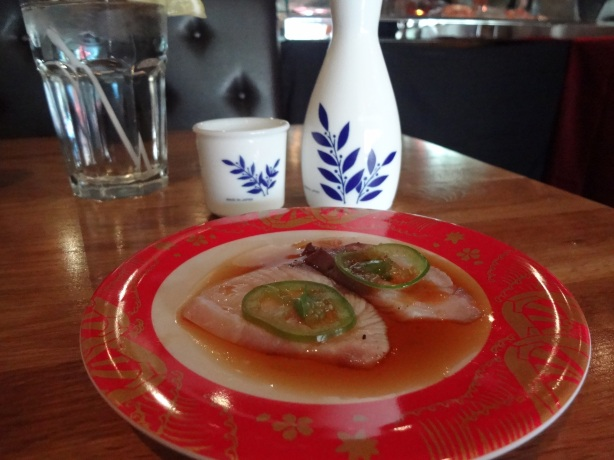 Jalapeno Yellowtail - torched yellowtail with thin sliced jalapeño, cilantro, tobiko, yuzu kosho sauce and ponzu sauce