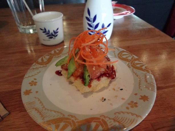 Sushi Pizza - Salmon, Avocado etc on a light tempura crust.