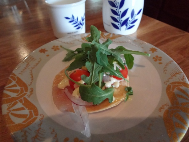 Sushi Tortilla - Salmon and tuna on a crispy rice tortilla with avacado, red onion, tomato, cilantro, jalapeno and arugula.