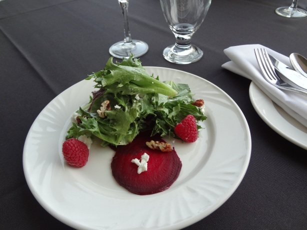 Summer Beet Salad with goat cheese, candied pecans and fresh raspberry tossed in poppy seed dressing